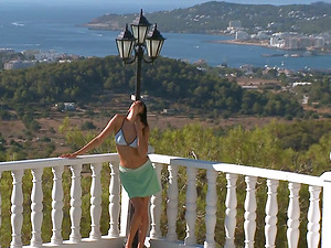 Superb Mia shows her perfect body on a balcony