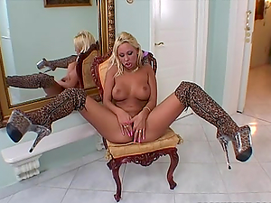 Sexy Adriana Russo in panther dress and high boots masturbates