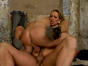 MANDY BRIGHT SUCKS AND RIDES TWO COCKS IN A BASEMENT